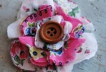 Handmade Flowers / There are so many pins of pretty handmade flowers made out of wool felt, burlap, sheet music, paper, tulle, crepe paper and assorted other mediums.  I love all the different textures and colors.  Apparently, flowers can be made from pretty much anything.  I even found some made from an old quilt.  Lovely handmade flowers... / by Sharon Dennison