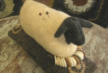 Sheep...lessness / I am a rug hooker and we use wool as our medium to make our rugs.  Therefore, sheep are important to us.  I like sheep pins and brooches, sheep crafts and little sheep figures for home decor.  We had a rug hookers' hook-in recently and sheep made from muslin with little bell eyes were given away as door prizes.  The sheep made very cute door prizes! / by Sharon Dennison