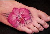Tattoos / by Cinnamon Swires