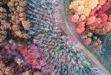 Drone photography / Drones are more formally known as unmanned aerial vehicles (UAVs) or unmanned aircraft systems (UASes). Essentially, a drone is a flying robot. It can be remotely controlled or can fly autonomously through software-controlled flight plans. A drone has applications in a variety of fields such as: search and rescue, security, science & research, aerial photography & video, surveying & gis (mapping), etc.