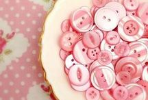 Crazy About Buttons............. / I become nostalgic thinking about buttons. Some of my earliest memories were of Mom and my grandma busily sewing for the four of us ALL of our clothing. Buttons were saved for reuse and kept in the special tin, which is now mine. I remember spending hours looking for matching buttons and just playing in the colorful magic box. Looking for the perfect projects for our prized vintage and older buttons.......