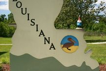 Louisiana / Kissed by the Gulf's mighty stream,  A lovely state, LOUISIANA,  Where sweet magnolias, so rare,  Perfume the air  With fragrance that's supreme.  God bless our lovely state.  It's a paradise right here on earth.  / by Suzy Thigpen-Thomas