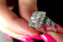 Engagement ring / She said yes. And she is very happy with the ring (she designed it) green stones are tsavourite garnets, my birthstone. And her birthstone is diamond. Lucky for her