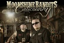 Moonshine Bandits / Anything and everything about the Hardest Working Band in the Music Biz today. The Moonshine Bandits have gone from a local band to a world wide hit. check out their websites for more info. www.MoonshineBandits.com www.ShinerTV.com