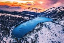 Elevate Lake Tahoe / Elevate Lake Tahoe is nestled in the Sierra Nevada Mountains on the border of California and Nevada in the Tahoe Basin. Surround yourself in the beauty of snow capped mountains, clear mountain air and the deep green waters of Emerald Bay.