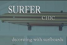 Decorating with Surfboards / Surfer ambiance can be stylishly infused Into any room with addition of wooden #surfboard. Classic wood #surfboards or decorative surfboards make fascinating wall accents. Hang them on any wall or use them to accent a window, or bring attention to architecturally interesting areas like alcoves in rooms. This works especially well in dens, studies and living rooms. Surfboards can even be placed together in interesting groupings to create unique, decorative headboards in a bedroom.  / by Inviting Home