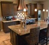 Traditional Old World Kitchen / This kitchen features Canyon Old World cabinets with a custom copper hood and sink basin, as well as a contrasting finish at the island.