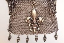 Chatelaines / Chatelaine is a decorative belt hook or clasp worn at the waist with a series of chains suspended from it. Each chain is mounted with a useful household appendage such as scissors, thimble, watch, key, vinaigrette, household seal, etc. The name chatelaine derives from the French term châtelaine, as it referred to a device designed to have all the tools necessary for the woman of the household to sort out any problem she may encounter in her day, like a fraying curtain.