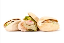 { Pistachios } / The Peanut Roaster is delighted to introduce in-the-shell California Pistachios to our lineup of gourmet nut products. A healthy snack, pistachios are high in potassium and iron. Try our seasoned pistachio flavors for a unique treat!