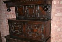 Jacobean  1603-1700 / Created during the reins of James I, II & Charles I, II and Cromwell, 1603-1700, England. Furniture of the time of the Mayflower. The first furniture to be brought to America and the first to be made in this country.  Mostly oak and pine, but also walnut, ash, cherry, hickory and elm. Carved stretchers, sloping arms, spiral turnings, ball and scroll feet, straight and turned legs.
