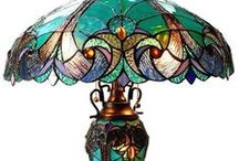 Tiffany / Louis Comfort Tiffany is an American glass designer who worked from 1879-1933.  His name appears on such items as iridescent glass (favrile), Art Nouveau and contemporary styles of design. He was noted for stained glass windows, vases, unusual lamps, bronze work, pottery and silver.