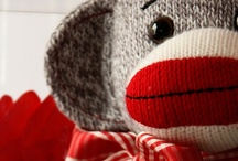 """I am the Sock Monkey / If you know me well, you have heard me sing """"Rainbow Sock Monkey, YEAH!"""" at least more than a million times.  I love, collect and just can't get enough of SOCK MONKEYS!   Feel the Sock Monkey, Learn from the Sock Monkey, BE the Sock Monkey!"""