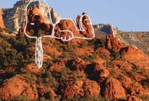 Sedona Rocks / Sedona's main attraction is its array of red sandstone formations. The formations appear to glow in brilliant orange and red when illuminated by the rising or setting sun. The red rocks form a popular backdrop for many activities, ranging from spiritual pursuits to the hundreds of hiking and mountain biking trails. Each Distinctive Red Rock Has A Name. Who gave them names is unknown but the name of each major formation resembles its shape. For example, the character Snoopy from the popular Peanuts comic strip lies on top of his doghouse. Another is Lucy, also from the Peanuts comic strip. Then there are Coffeepot Rock, Bell Rock, Cathedral Rock, Chimney Rock, Courthouse Butte, The Mittens, The Cow Pies, and the Rabbit Ears. From the front door of Chapel of the Holy Cross, take a peek at Eagle Head Rock as well as the Twin Nuns and Mother and Child Rock buttes. The Three Golden Chiefs and Capitol Butte can be seen from Coffee Pot.