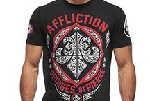 "Affliction T-Shirts / Affliction clothing for Men is a high-end brand inspired by music, art and culture of the times, including Rock & Roll, Moto Culture, Counter Culture, Tattoo, Vintage Americana, and Impact Sports such as MMA. The designs by Affliction Apparel have been tied to some of the biggest names in sports, including Cain Velasquez, GSP Georges St. Pierre, Randy Couture and many other Mixed Martial Arts Champions. Contemporary fashion, Affliction encourages you to ""Live Fast, Die Young""."