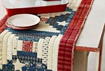 Red, White, and Blue / Red, white, and blue fabrics are the focus of these patriotic quilts and table toppers! See more here: allpeoplequilt.com/holiday-quilts/summer/patriotic-quilt-patterns