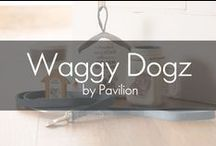 Waggy Dogz by Pavilion® / Good days turn great when you come home to the love of your pet. And what better way to show off your love than with some great pieces the feature your favorite breed. Waggy Dogz is an adorable collection of mason jar mugs, bamboo magnets, and house-shaped door stoppers featuring the charming work of Christine Varley. This collection is enhanced with classic colors, sweet sentiment, and delightful breed-specific artwork.