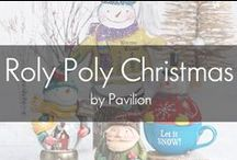 Roly Poly Christmas by Pavilion / Featuring the artwork of Laura Benge, Roly Poly Christmas is a fun, youthful take on holiday gift and decor items. Laura creates her whimsical artwork from her studio, located in her Iowa home. MDF plaques, ornaments, water globes, and mugs showcase whimsical snowmen and gnome-like santas that express the perfect holiday cheer.