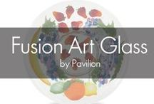 Fusion Art Glass by Pavilion / Fusion Art Glass is a timeless treasure of beauty, art, and function perfect for your home. These exquisite designs are made from an intricate process of stenciling layers of powdered enamel on a glass surface. After the designs are tediously created, another piece of glass is placed on top, and then kiln fired for upwards to 20 hours, which fuses the glass and the color together. The end result is a handcrafted, one of a kind, colorful glass art form.