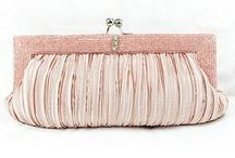 Wedding Clutches and Purses / A wedding handbag adds the final touch. It's a perfect place for that touch up foundation and your lipgloss. Have a look at these amazing clutches and purses.