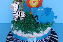 BABY BOY DIAPER CAKES / HAD SO MUCH FUN MAKING A DIAPER CAKE FOR MY SOON TO BE GREAT GRAND SONS BABY SHOWER. ADDING YOUR OWN PERSONAL TOUCH MAKES IT THAT MORE MEMORABLE AND SPECIAL. / by Rosie Lujan