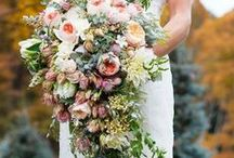 Cascade Bouquets / Cascades are making a comeback and so are the simple presentation bouquets, but the newest rage I've seen, is wired orchids trailing off  hand-tied bouquets.  I love to the movement in cascades and to design them wrapping the natural stems instead of a bouquet holder.
