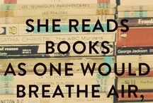 She reads books as....  / book love