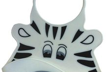 Catch All Feeding Bibs / More fun less mess with our funky Catch All Baby Bibs. Bring a touch of style to your baby or toddler's meal times.  Our soft and durable 100% silicone grade weaning or feeding bibs come in fun and funky animal designs that your baby or toddler will love and will want to wear again and again.  Our baby bibs are great quality and practical too with adjustable neck and crumb catcher.  Easy to clean, simply wash in soapy water or even put in the dishwasher!