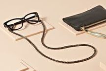 Accessories / They're here! These high quality, avant-garde chains and cases boast a litany of premium materials, including: glass pearls with the most realistic high gloss finish, sleek lightweight links, and genuine Italian leathers. With our free return policy, we make dressing up your frames as easy as can be.