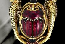 Egyptian Revival jewelry. / Jewelry inspired by the ancient Egyptians, made long after they were gone.