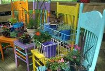Chair Planters in the Garden / blooming benches, flower pots, junk garden, yard art / by ThreeOldKeys Laurie C