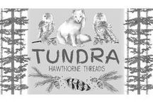 Tundra / Inspiration for our fabric collection Tundra collection, featuring white snowy owls and arctic foxes, pine cones, feathers and trees.