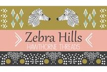 "Zebra Hills / Zebra Hills celebrates Thoreau's adage that ""all good things are wild and free."" The line builds upon the beautifully graphic profile of a Burchell Zebra, available on six colors that are equally at home in your home and wardrobe. Supporting prints inspired by traditional mudcloth and woven basket designs round out this timeless yet on trend range. DIY. Fabric. Sewing. Africa. Safari."