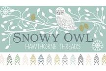 Snowy Owl / We have another In House designed and printed fabric collection for you all! Journey to the frozen north where the majestic Snowy Owl stands sentry to a sea of trees. These silent watchers in the woods exude a quietude broken only by the hush of new fallen snow. The collection is told in three color stories, Daybreak, Evening Sun, and Night, each with a Faux Patchwork Print, Project Panel, and Quilt Panel!