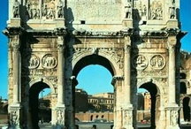 The Arch of Constantine / The Arch of Constantine is an enormous triumphal arch in Rome, between the Colosseum and the Palatine Hill. It was erected by the Roman Senate to commemorate Constantine the Great's victory over Maxentius at the Battle of Milvian Bridge on October 28, 312. Dedicated in 315, it is the last great monument built in ancient Rome, and re-used sculptures from 2nd century imperial monuments -- which shows that the city was already in decline financially and artistically. / by The Spanish Steps Apartment Rome Italy Rome, Italy