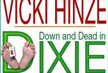 Down and Dead Inc Series / The books in Vicki's zany and humorous romantic mysteries.