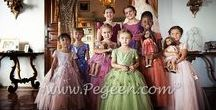 Flower Girl Dress of the Year / Pegeen's annual Wedding of the Year Highlights our Favorite flower girl dresses and weddings from our customers. Manufacturers of flower girl dresses & boys suits - Infants to Plus Size. 200+ colors in Silk. Headquartered in Orlando FL .. 1 mile from Disney!! 407.928.2377