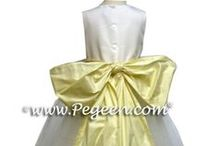 Yellow flower girl dresses / Flower girl dresses by pegeen.com in mustard, saffron, buttercreme,  baby chick, goldenrod, grapefruit, lemonade, papaya, sunflower.  Flower girl dresses in shades of yellow.Pegeen.com is a manufacturer of flower girl dresses & boys suits - Infants to Plus Size. 200+ colors in Silk. Headquartered in Orlando FL .. 1 mile from Disney!! 407.928.2377