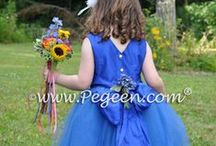 Blue Flower Girl Dresses & Weddings / Flower girl dresses and wedding ideas in all shades of blue. Soft pastels to rich, vibrant hues of blue.  Blue cakes, decor, flowers, jewels and more. Pegeen.com is a manufacturer of flower girl dresses & boys suits - Infants to Plus Size. 200+ colors in Silk. Headquartered in Orlando FL .. 1 mile from Disney!! 407.928.2377