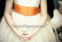Orange Flower Girl Dresses & Weddings / Flower girl dresses and wedding ideas in all shades of Orange, Coral, Peach, Melon, Sunset, Tangerine and more. Pegeen.com is a manufacturer of flower girl dresses & boys suits - Infants to Plus Size. 200+ colors in Silk. Headquartered in Orlando FL .. 1 mile from Disney!! 407.928.2377