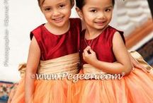 Red Flower Girl Dresses & Weddings / The color red. Nothing gets attention like red does.  See strikingly beautiful red Pegeen flower girl dresses, as well as red decor, red cakes, red flowers, and much more. Pegeen.com is a manufacturer of flower girl dresses & boys suits - Infants to Plus Size. 200+ colors in Silk. Headquartered in Orlando FL .. 1 mile from Disney!! 407.928.2377