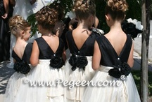 Black Weddings & Flower Girl Dresses / The classic look in basic black weddings.  See gorgeous Pegeen flower girl dresses in many styles in the color black.  See black as the main attraction, or as an accent color in the decor, the cake, the attire, the favors, and much more. Pegeen.com is a manufacturer of flower girl dresses & boys suits - Infants to Plus Size. 200+ colors in Silk. Headquartered in Orlando FL .. 1 mile from Disney!! 407.928.2377