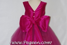 Hot Pink Flower Girl Dresses / Flower girl dresses in hot pink shades.  Pegeen Custom Silk flower girl dresses in hot pink, barbee pink, boing, cerise, flamingo, fuchsia, gumdrop, lipstick pink, luscious, magenta, lollipop, raspberry, shock, sorbet, rose pink. Pegeen.com is a manufacturer of flower girl dresses & boys suits - Infants to Plus Size. 200+ colors in Silk. Headquartered in Orlando FL .. 1 mile from Disney!! 407.928.2377