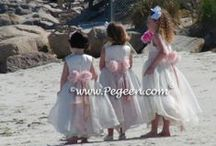 Beach Flower Girl Dresses & Weddings / By the sea or lake side, beach weddings play a beautiful part in our memories of happiness and family. Share your favorite sea-shells here! Pegeen.com is a manufacturer of flower girl dresses & boys suits - Infants to Plus Size. 200+ colors in Silk. Headquartered in Orlando FL .. 1 mile from Disney!! 407.928.2377
