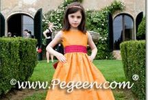 Destination Flower Girl Dresses & Weddings / Flower girl dresses by Pegeen appear all over the world!  We may not be able to travel as much but it's sure fun when we get to see our bride's destination weddings. Pegeen.com is a manufacturer of flower girl dresses & boys suits - Infants to Plus Size. 200+ colors in Silk. Headquartered in Orlando FL .. 1 mile from Disney!! 407.928.2377