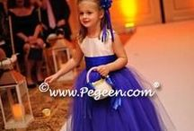 Peacock Weddings & Flower Girl Dresses / Flower Girl Dresses in Teal And all colors of Peacock. Pegeen.com is a manufacturer of flower girl dresses & boys suits - Infants to Plus Size. 200+ colors in Silk. Headquartered in Orlando FL .. 1 mile from Disney!! 407.928.2377
