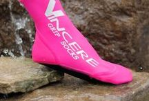 Clasic High Top Grip Socks / Enjoy the secure feeling of our anti-slip, traction grip water sports socks. Grip the board with the rough neoprene Traction Grip Sole Protect your feet while portaging your kayak or negotiating water hazards, slippery rocks or splintered docks. Neoprene heel and toe protect from chafing due to bindings or full foot fins. Lightweight breathable spandex uppers gives barefoot feel and dry quickly