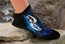 Aqua Sprites Grip Socks / Perfect for all water sports. Aqua Sprites are low cut and easy to slip on and off with a snug-fit neoprene band. Enjoy the secure feeling of our anti-slip sole with traction grip for water sports. The rough neoprene Traction Grip Sole gives you traction on smooth surfaces. Protect your feet from water hazards, slippery rocks, splintered docks, hot sand and chafing due to bindings or full foot fins. Lightweight breathable spandex uppers gives barefoot feel and dry quickly.