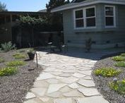 Garden Grove Recycled Yard / Concrete pieces from what was once a cracked walkway gets reused to create a new path. Drought tolerant plants invite the local birds to hang out and other elements ad some pizzazz.