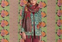 """Garment / A way, a definite style that is not ethnic because too refined, and not fashionable because never out of fashion.  Organza kaftans, light muslin kurtas, ghagra skirts and """"grettate"""" shirts. There are also wrap-around sarongs, scarves, handbags and belts, all in the bright coloured patters of oriental inspiration."""