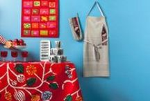 Marimekko Kitchen / Brighten up your kitchen decor with all things Marimekko. Created from popular Marimekko fabric swatches, these Marimekko aprons, tea towels, table cloths, etc.. are colorful, creative and fun.